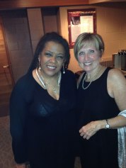 Felicia Collins (guitar & vocals) with TBCAF Board President Susan Lester